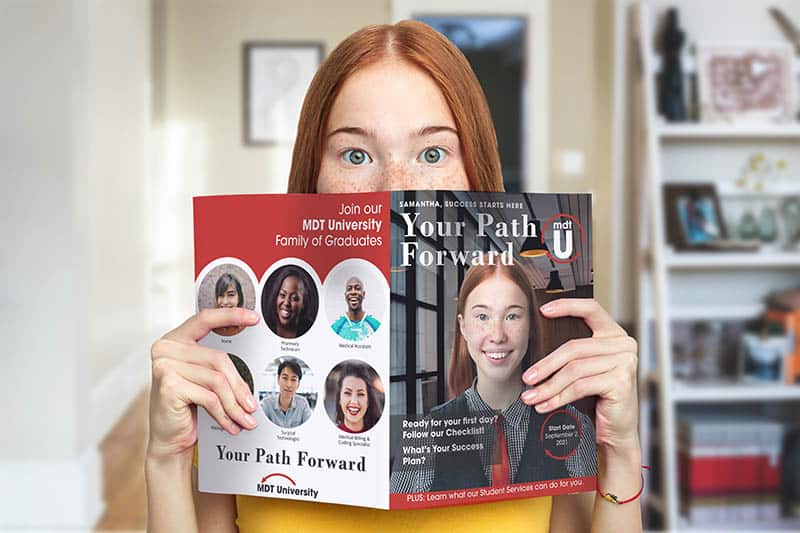 young woman reading a magazine with her face on it