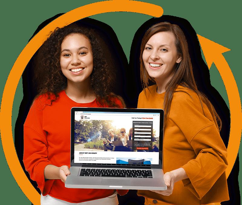 two women holding laptop showing digital advertising